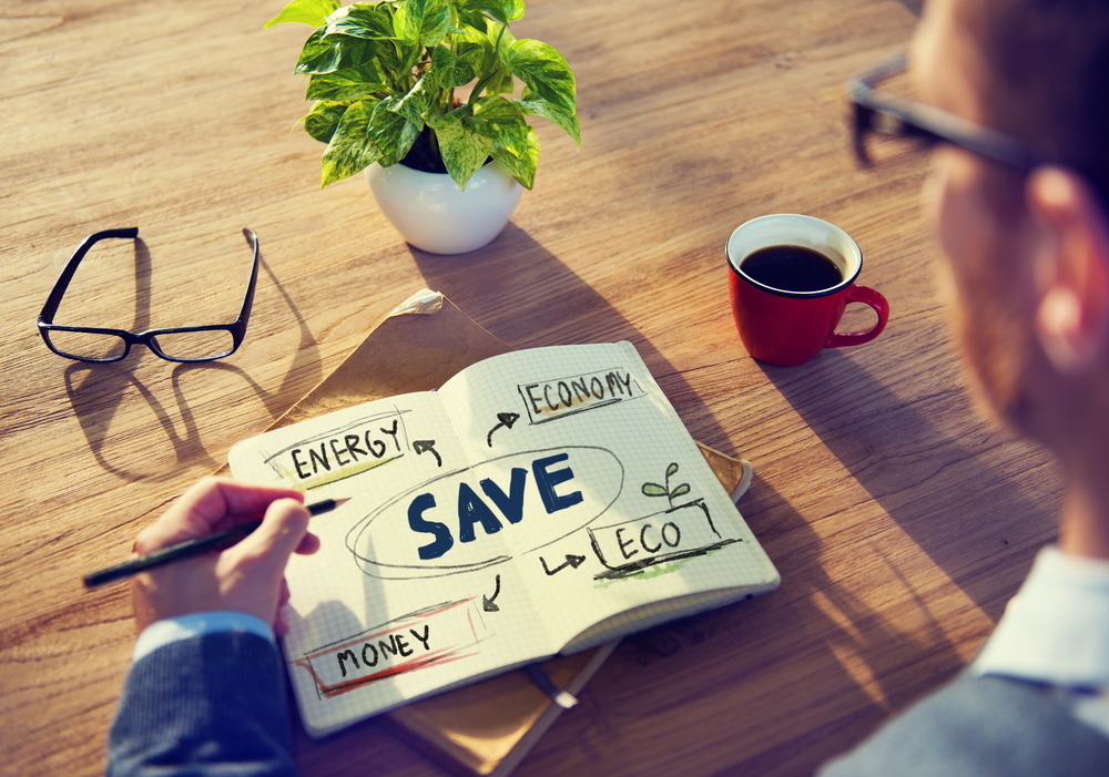 A man takes notes on how to save